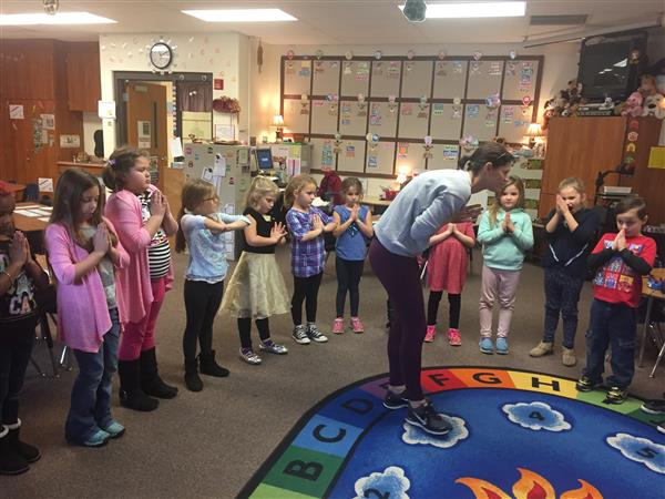 First Graders Participate in Yoga in the Classroom